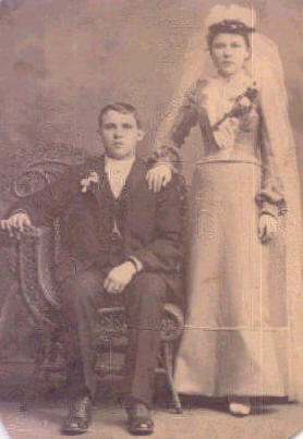 Mary and Williams Wedding Photo. It was typical at that time that the groom would sit and the bride would stand as they are doing.